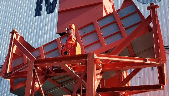 vibratory chute conveyor hopper noise reduction